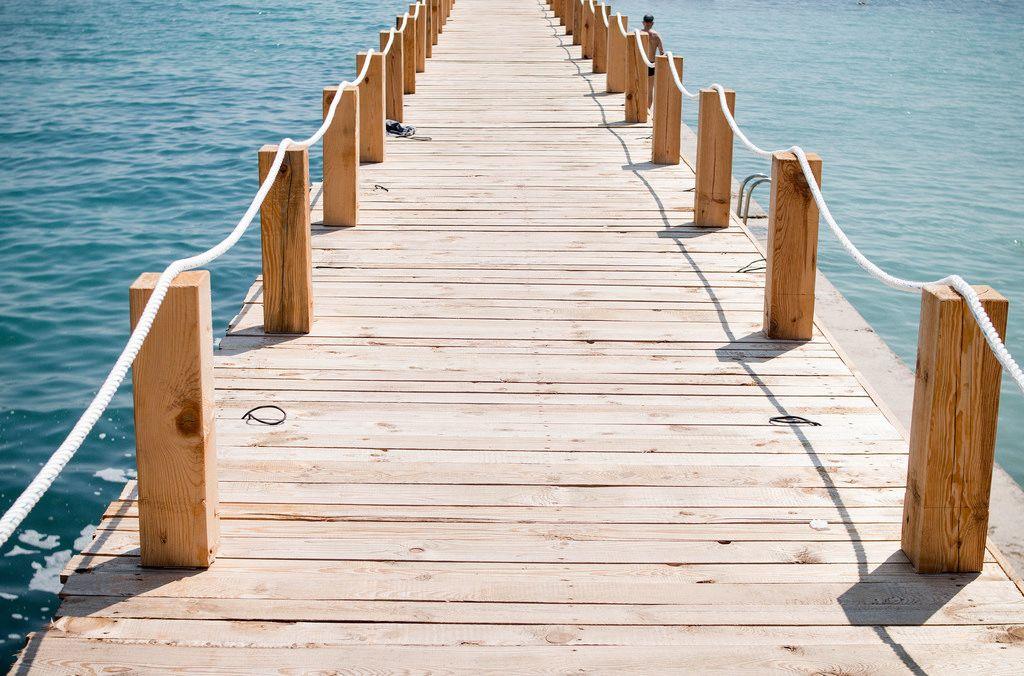 Freedom: Wooden bridge to the sea.