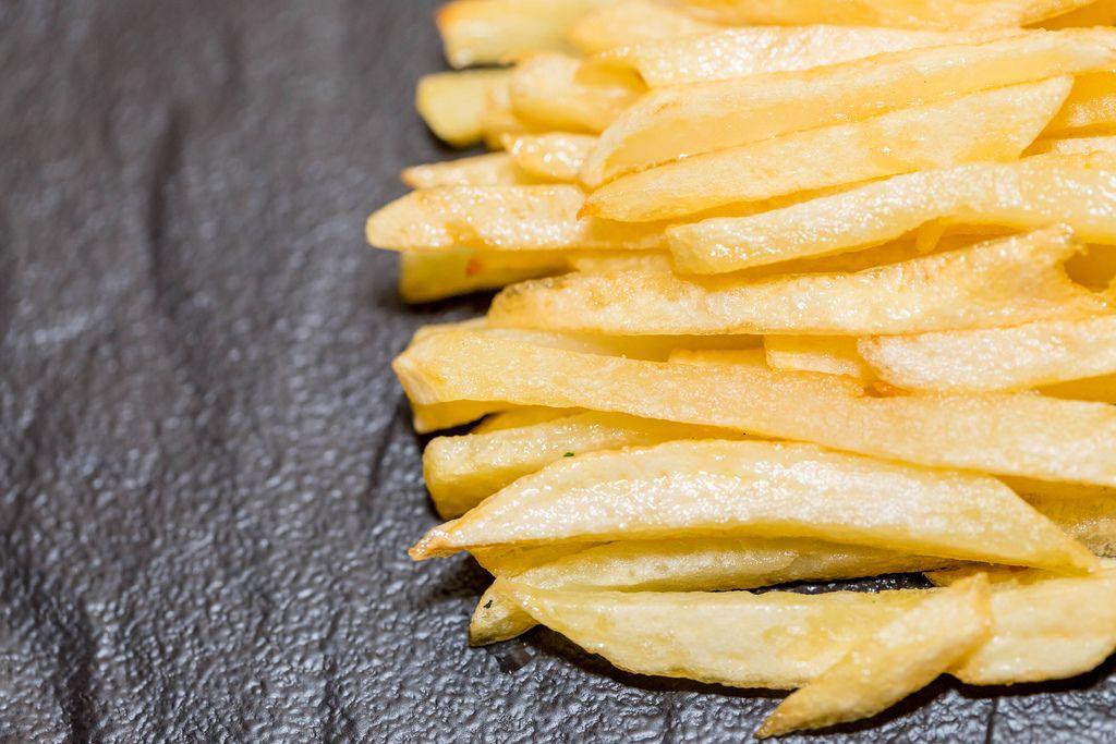 French fries on black background (Flip 2019) (Flip 2019) Flip 2019