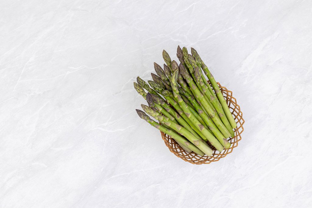 Fresh Asparagus in the woven basket