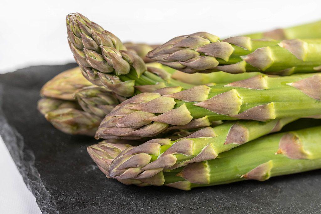 Fresh Asparagus on the black tray