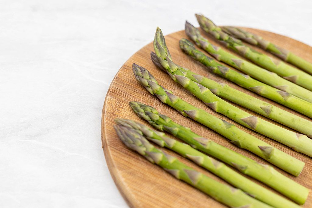 Fresh Asparagus on the wooden board