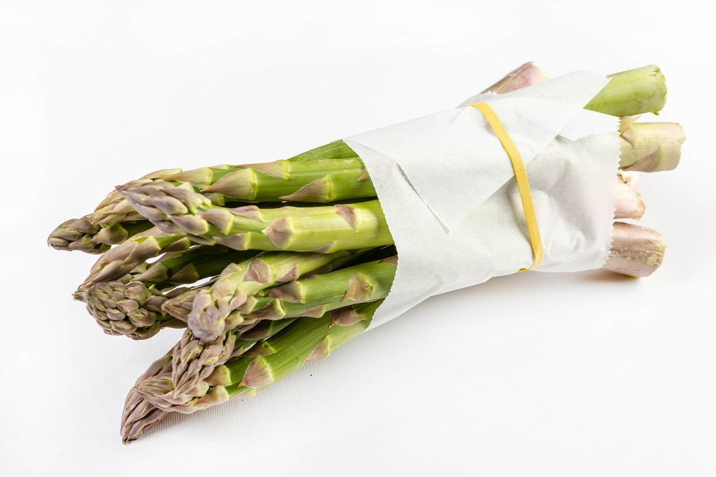 Fresh Asparagus packed with the paper