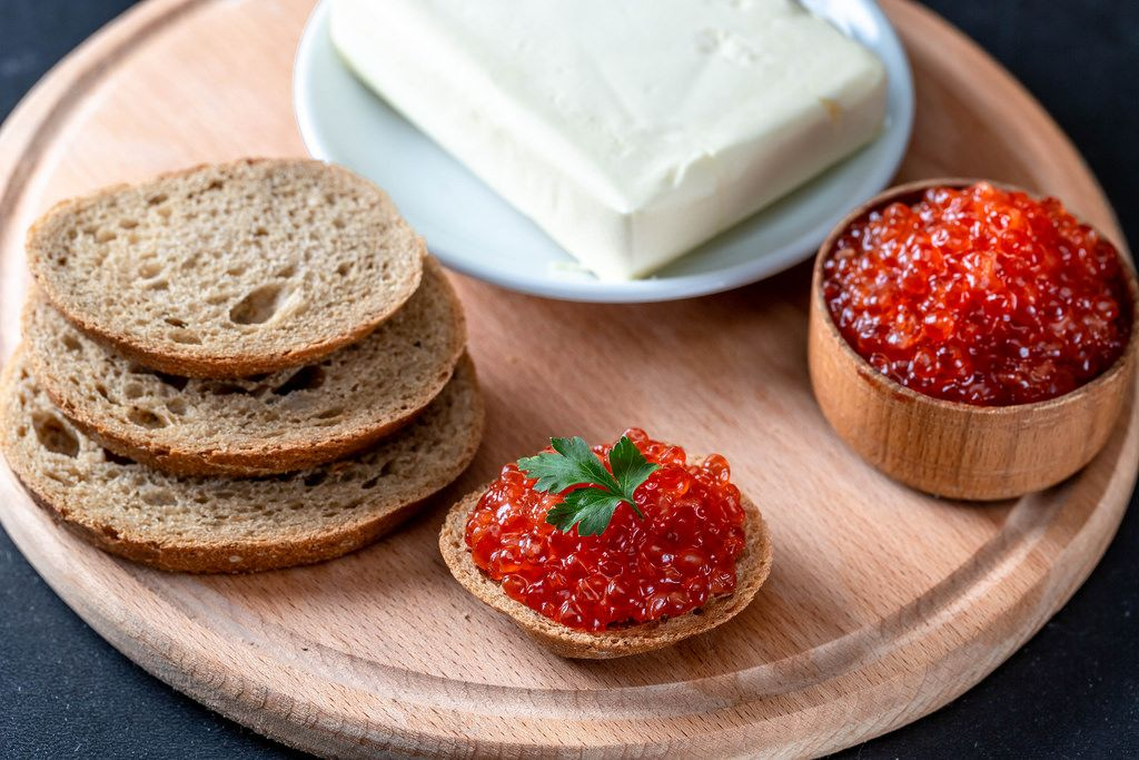 Fresh black bread, butter and red caviar