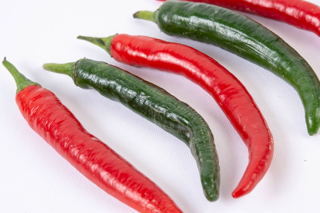 Fresh Chilli Red and Green Hot Peppers isolated above white background (Flip 2019)