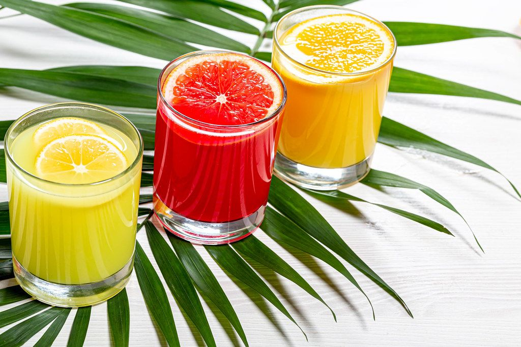 Fresh citrus juices with green leaf