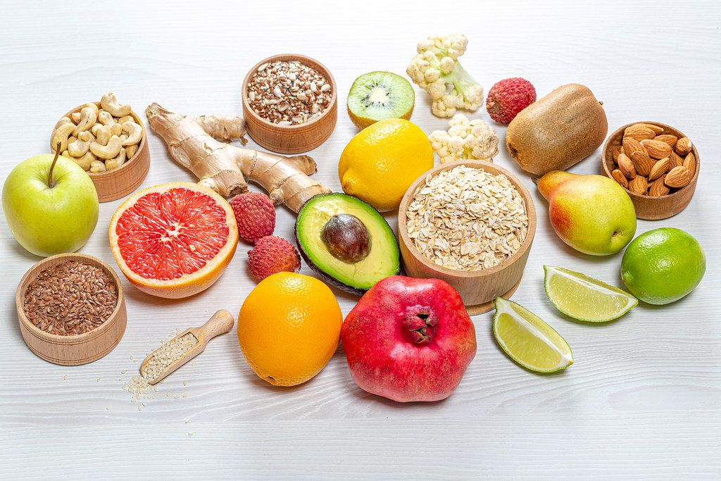 Fresh fruit, nuts, seeds and oatmeal. Healthy food background