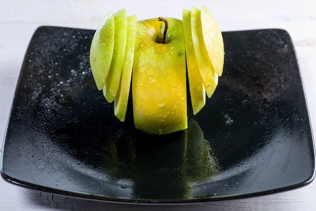 Fresh green Apple sliced on a plate (Flip 2019)