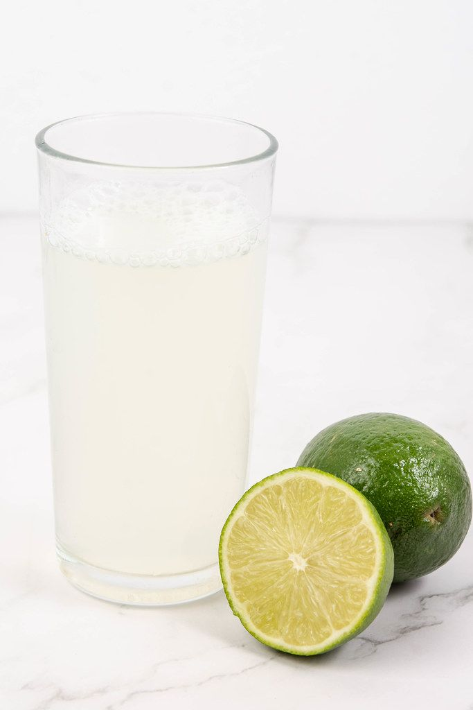 Fresh Green Limes juice on the white table