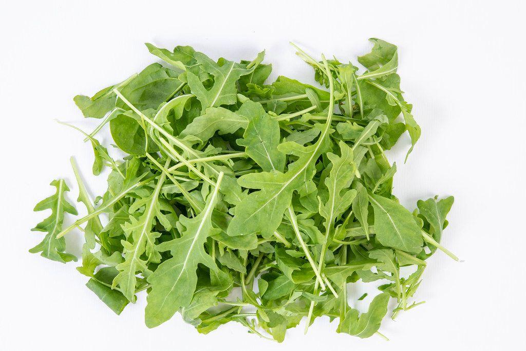 Fresh Healthy Green Rucola above white background (Flip 2019)