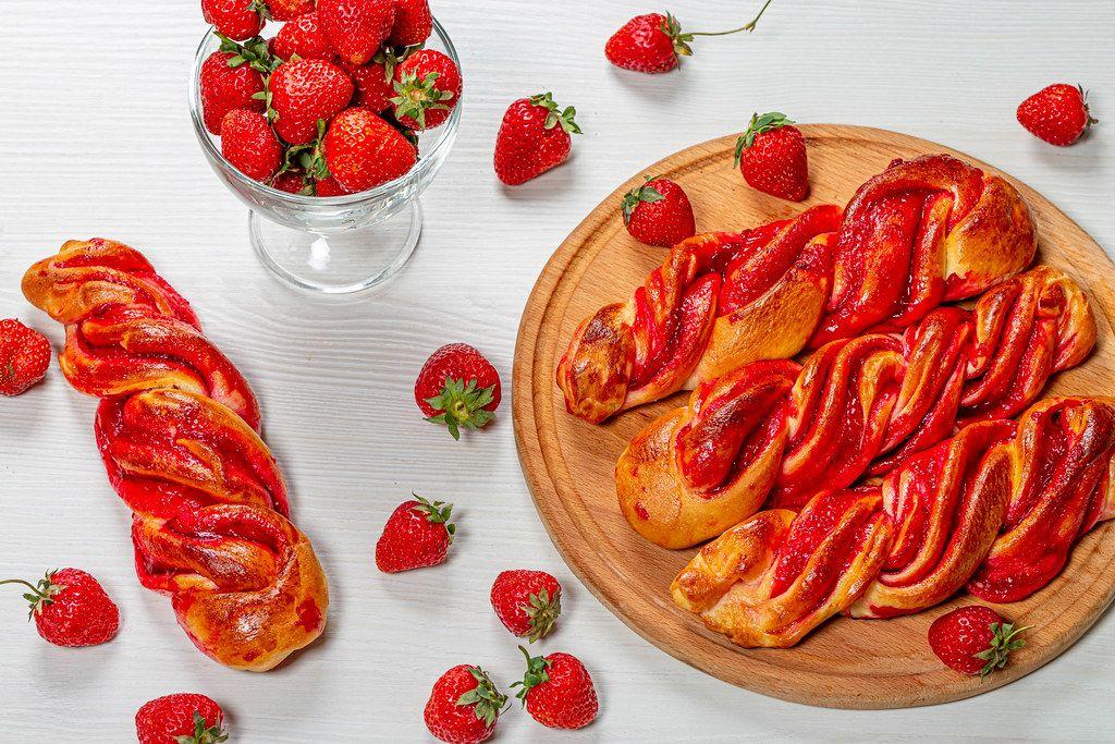 Fresh homemade buns with strawberry jam and fresh strawberries (Flip 2019)