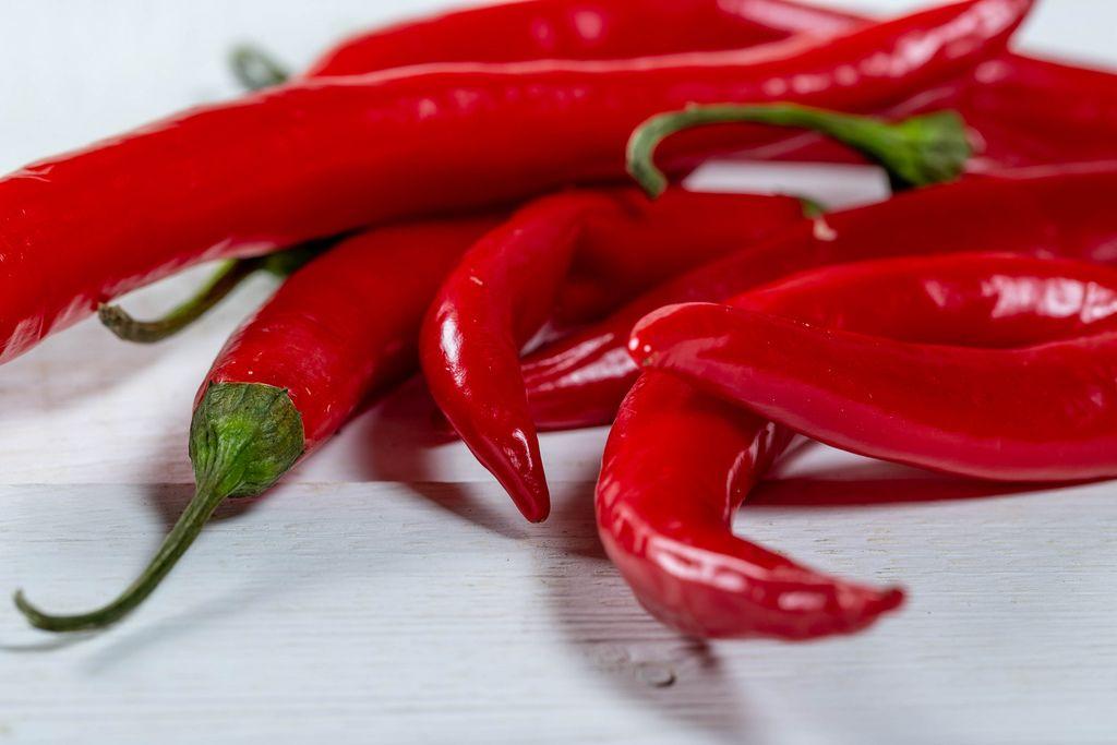 Fresh hot red pepper on white background