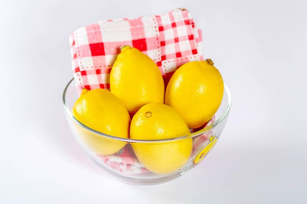 Fresh lemons in a glass bowl