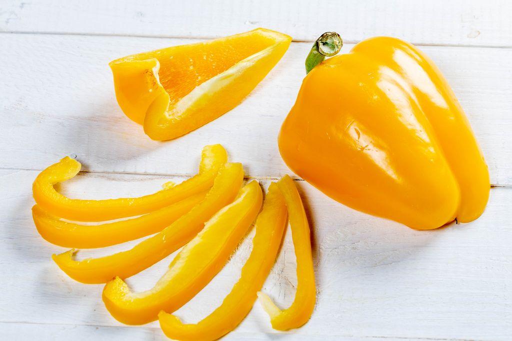 Fresh orange bell pepper on a white wooden background (Flip 2019) (Flip 2019) Flip 2019