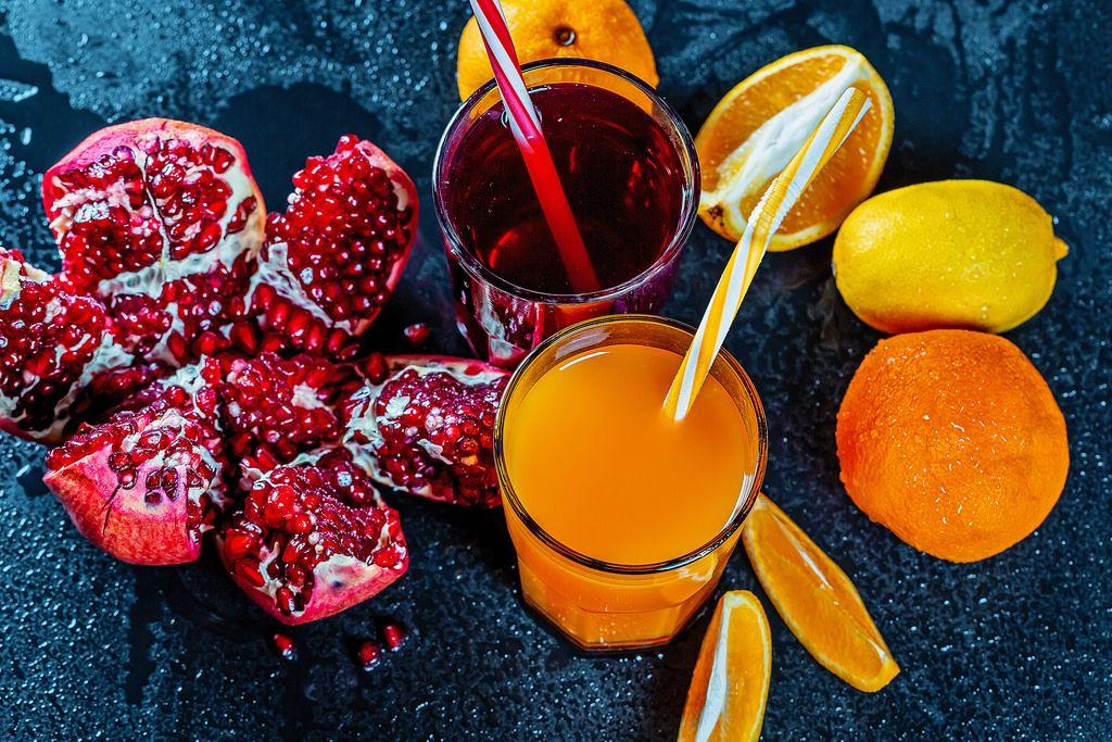 Fresh pomegranate and orange juice with ripe fruit