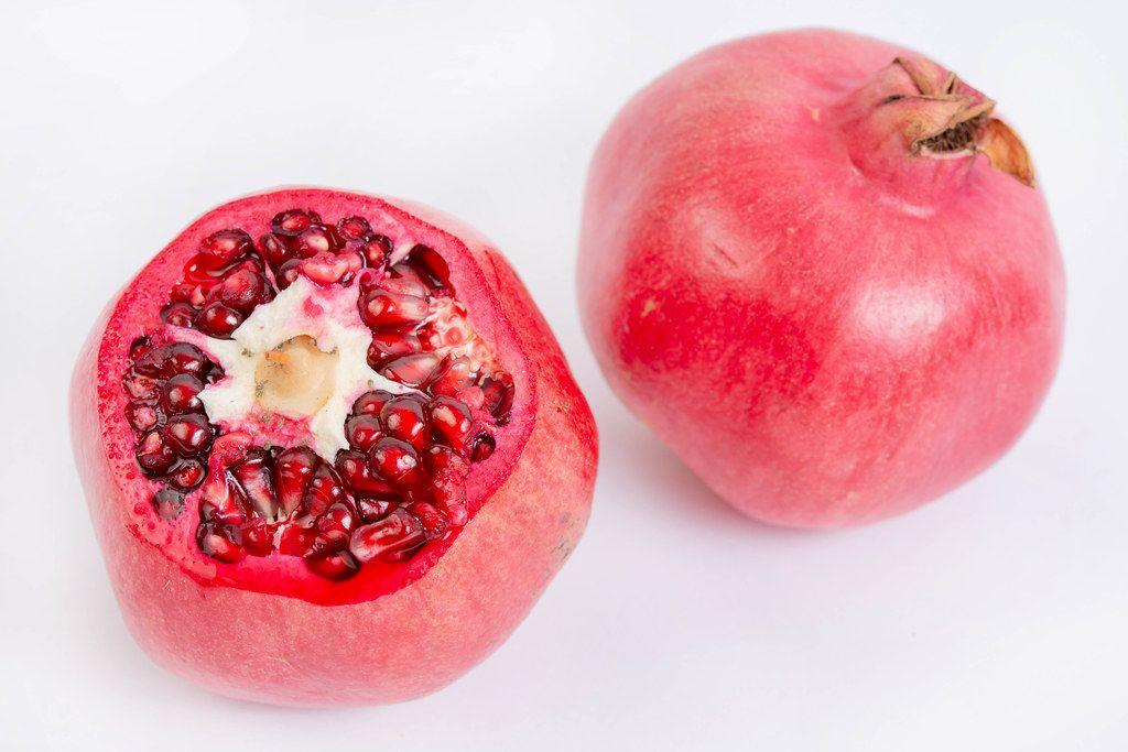 Fresh Pomegranate isolated above white background