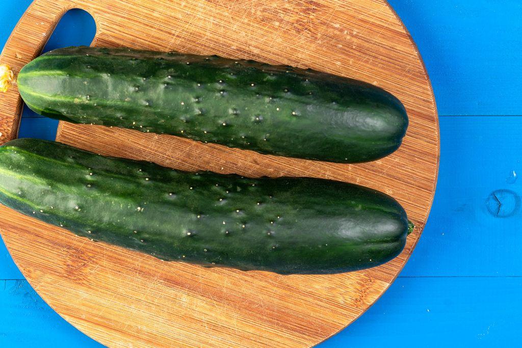 Fresh Raw Cucumber on the kitchen wooden board (Flip 2019)
