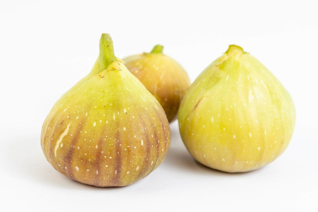 Fresh raw Figs isolated above white background
