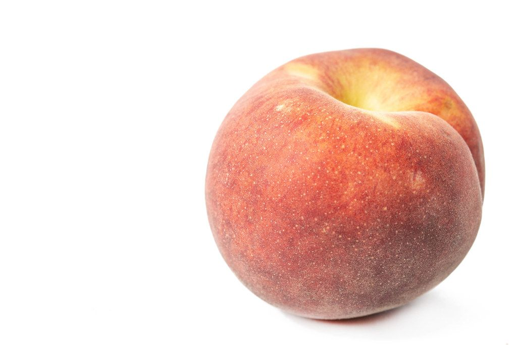 Fresh Raw Peach isolated above white background