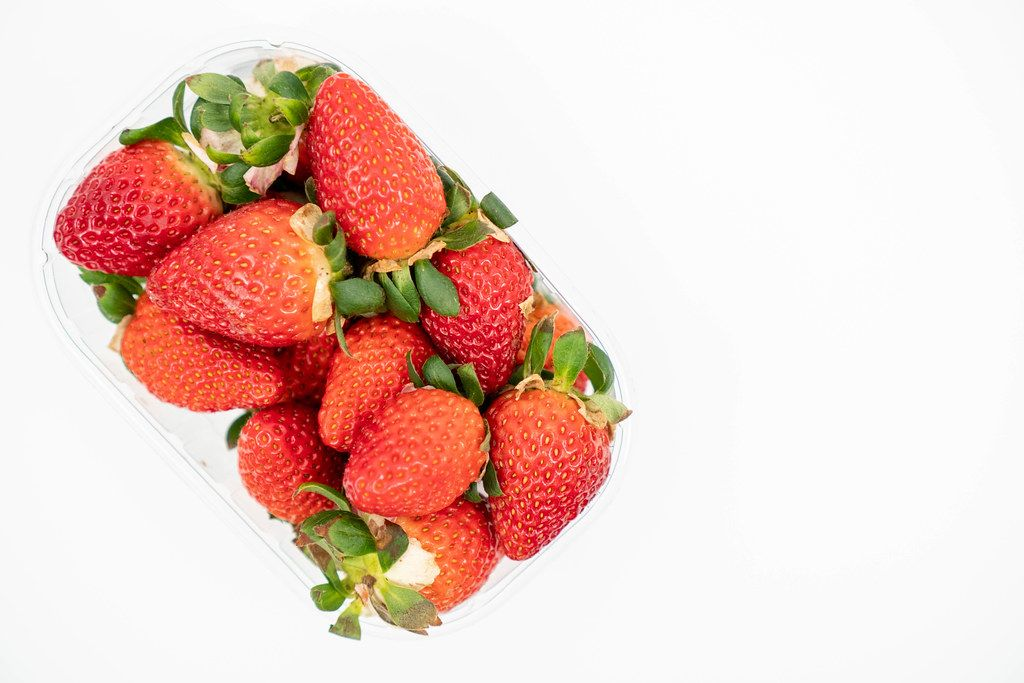 Fresh Raw Strawberries above white background with copy space (Flip 2020)