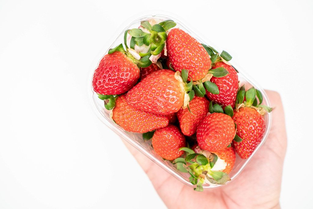 Fresh Raw Strawberries in the plastic box with copy space (Flip 2020)