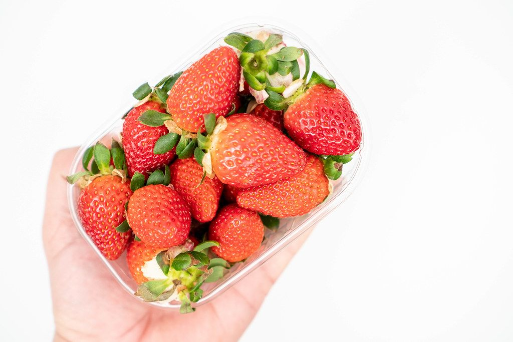 Fresh Raw Strawberries in the plastic box with copy space