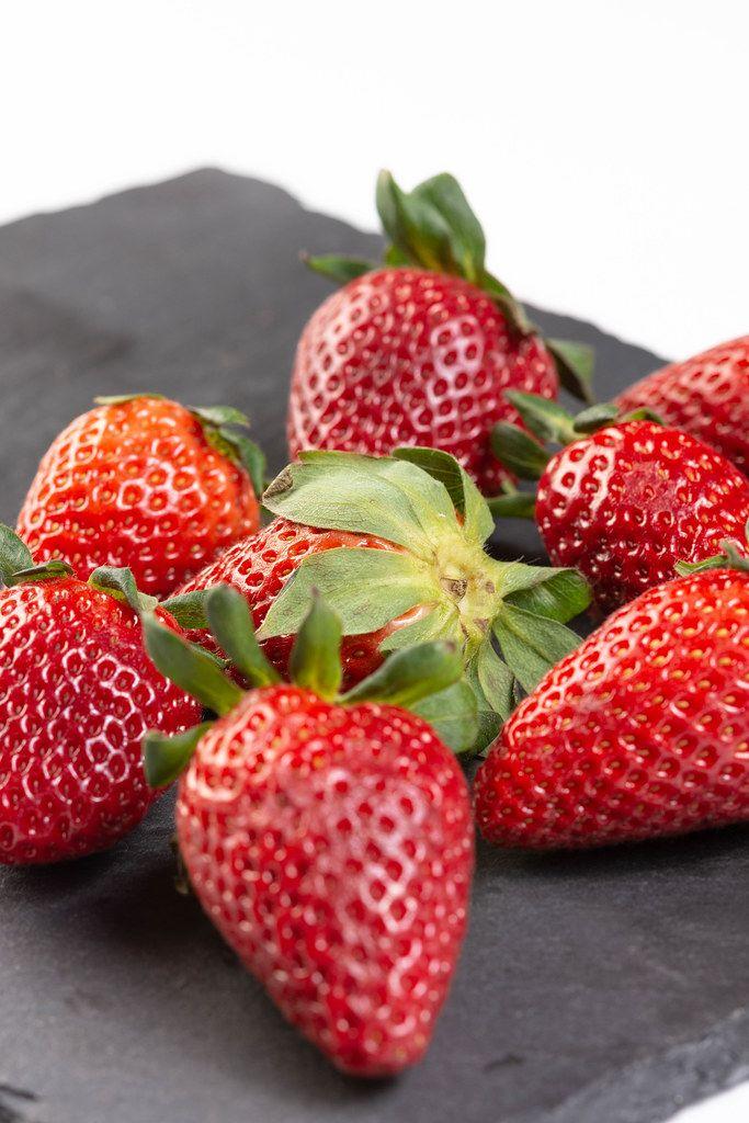 Fresh Red Strawberries on the black tray (Flip 2019)
