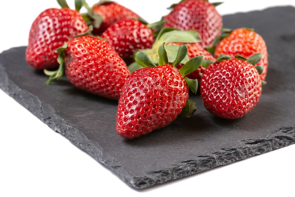 Fresh Red Strawberries on the stone tray
