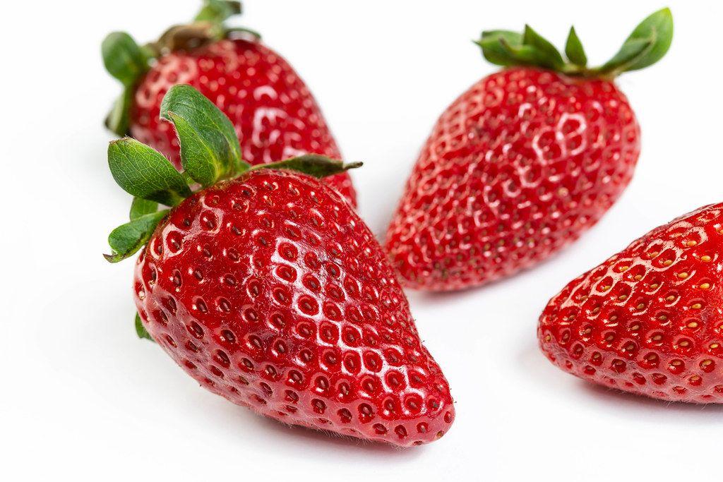 Fresh Red Strawberries on the white background (Flip 2019)