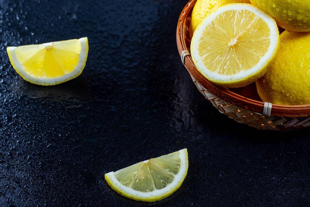 Fresh ripe lemons on black background