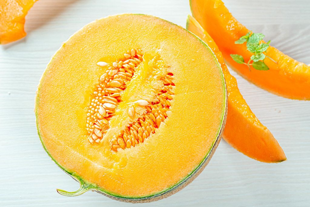 Fresh ripe melon with mint leaves