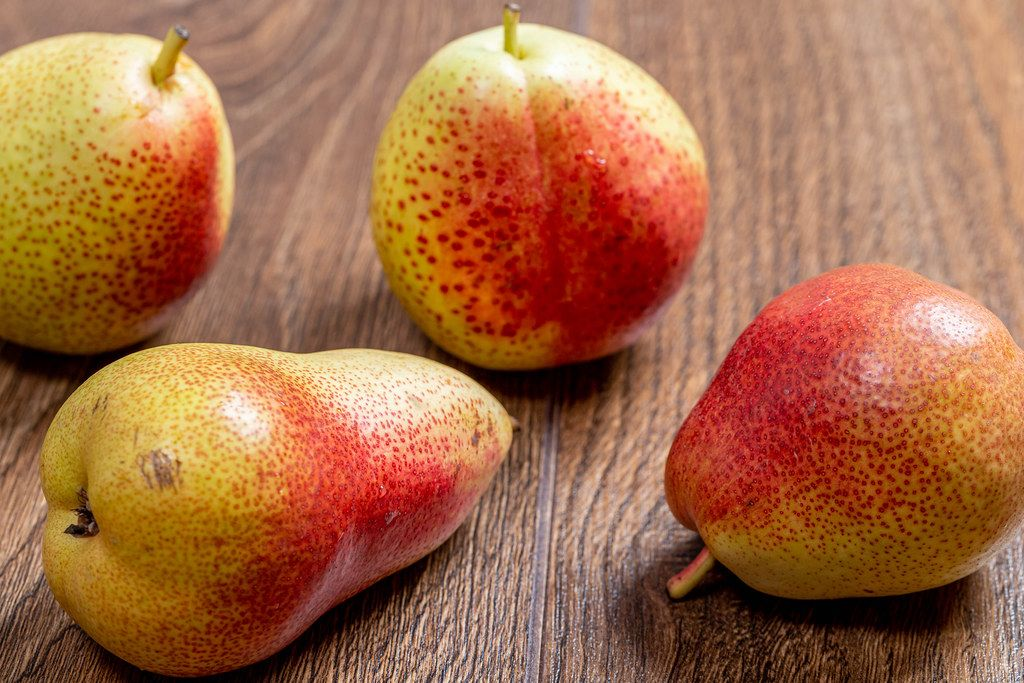 Fresh ripe pears on brown wooden background (Flip 2019)