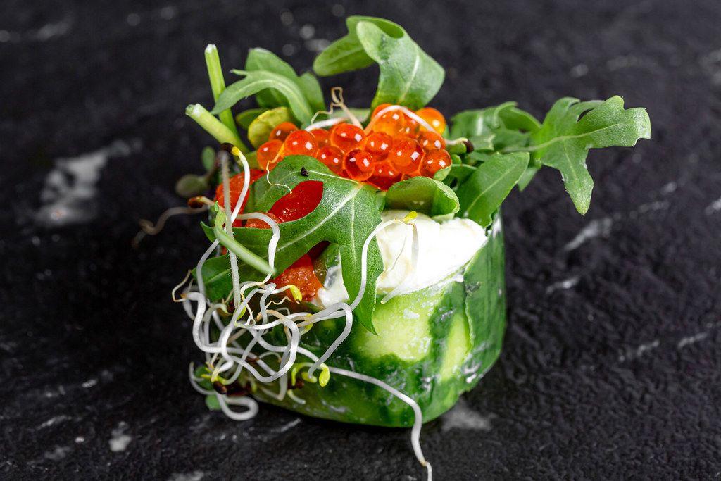 Fresh roll with cucumber, salmon, California cheese, arugula, micro greens and red caviar