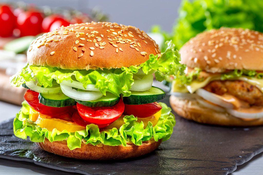 Fresh tasty burger on black stone tray