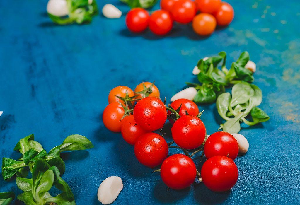 Fresh Tomatoes on Blue Background (Flip 2019)