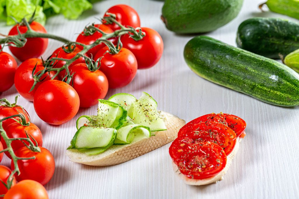 Fresh vegetables and sandwiches with sliced tomatoes and cucumbers (Flip 2019)
