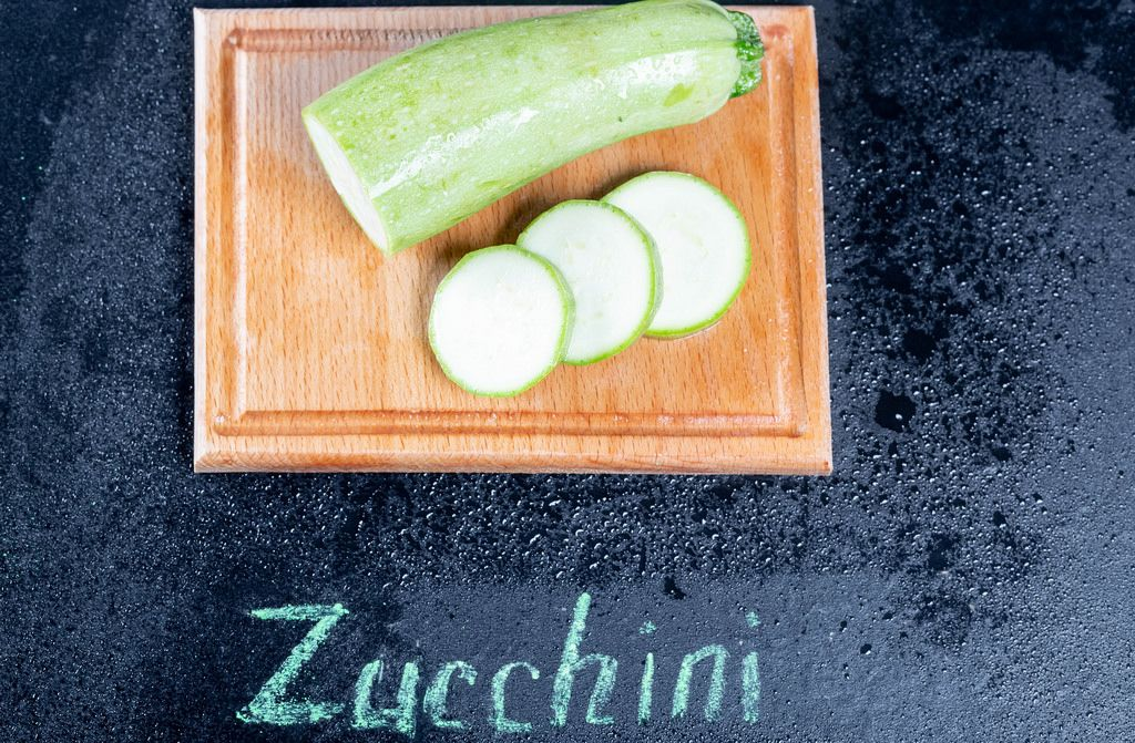 Fresh zucchini on the kitchen Board with the inscription