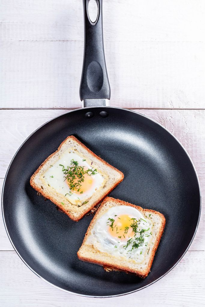 Fried eggs with bread and herbs in a frying pan (Flip 2019)