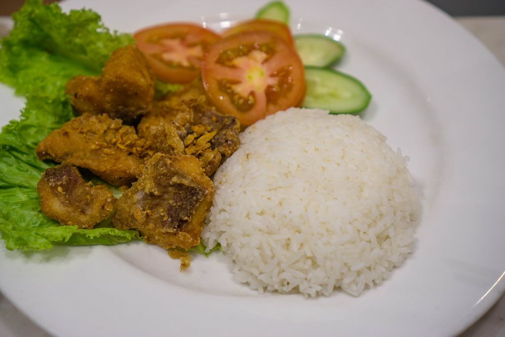 Fried Fish with Rice and Vegetables in Ho Chi Minh City