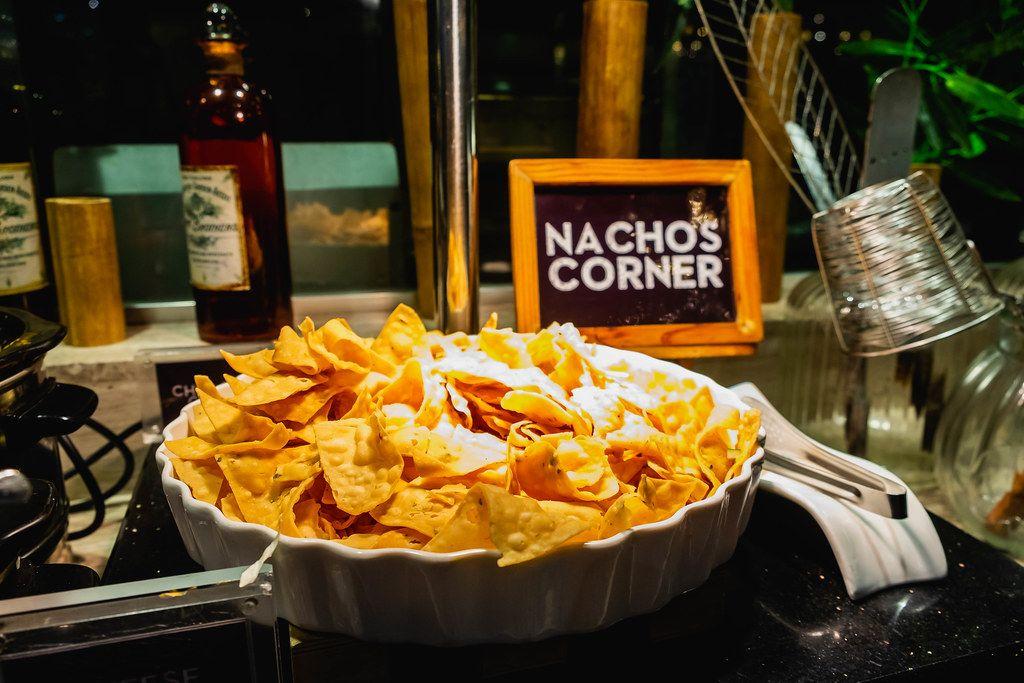 Fried nachos in white bowl on display