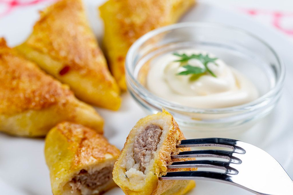 Fried pancakes with meat filling and white sauce (Flip 2019)