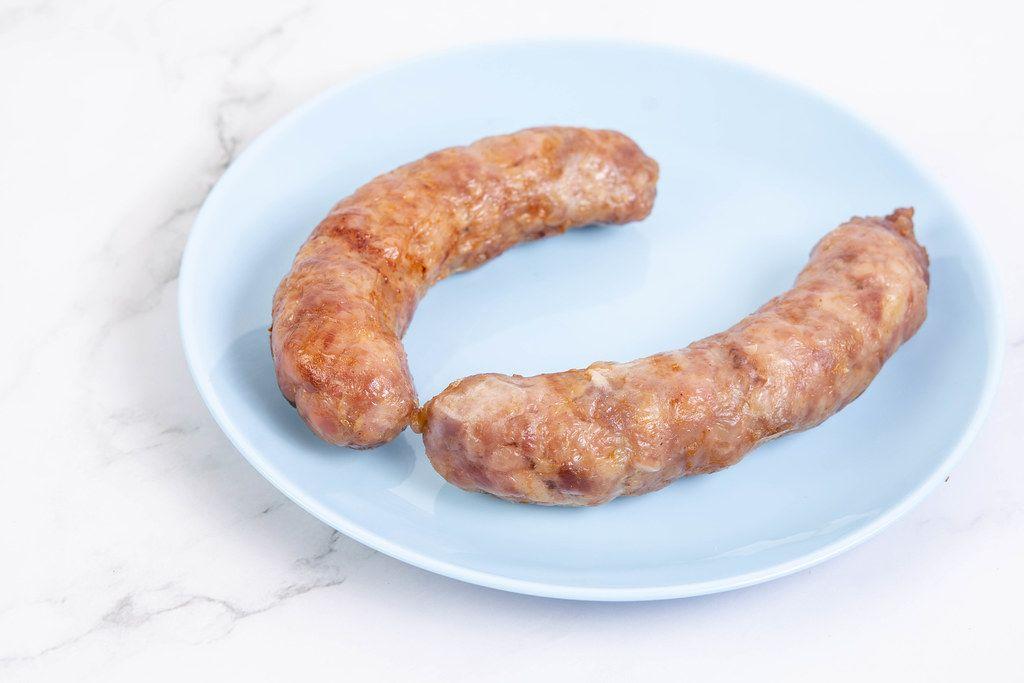 Fried Pork Sausages served on the blue plate