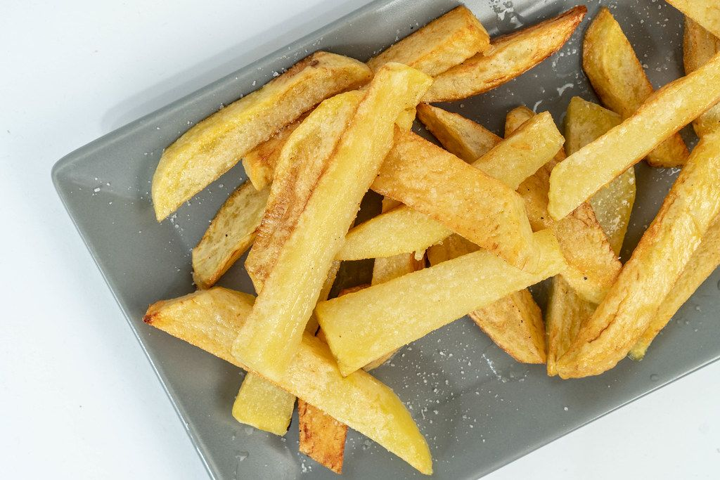 Fried Potatoes on the plate above white background