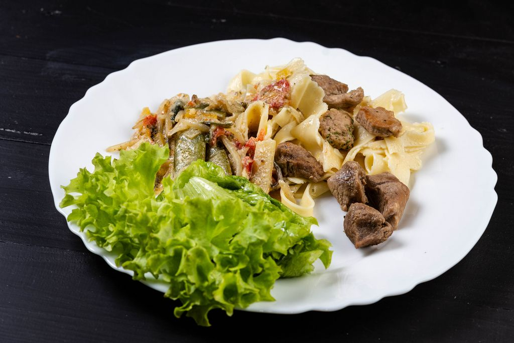 Fried Vegetables with Pork Meat and Lettuce in the plate