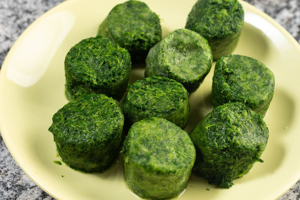 Frozen cubes of spinach on the plate