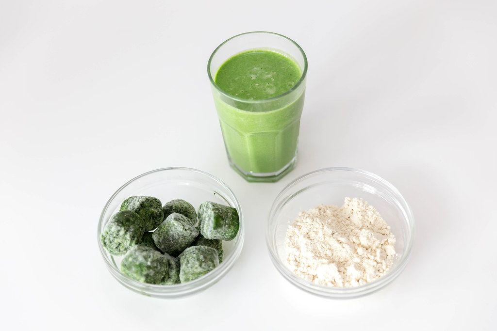Frozen spinach and white almond powder: ingredients for a sugar free green protein drink for athletes