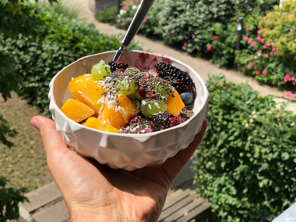 Fruit salad with mango, grapes, blackberries, blueberries and chia seeds