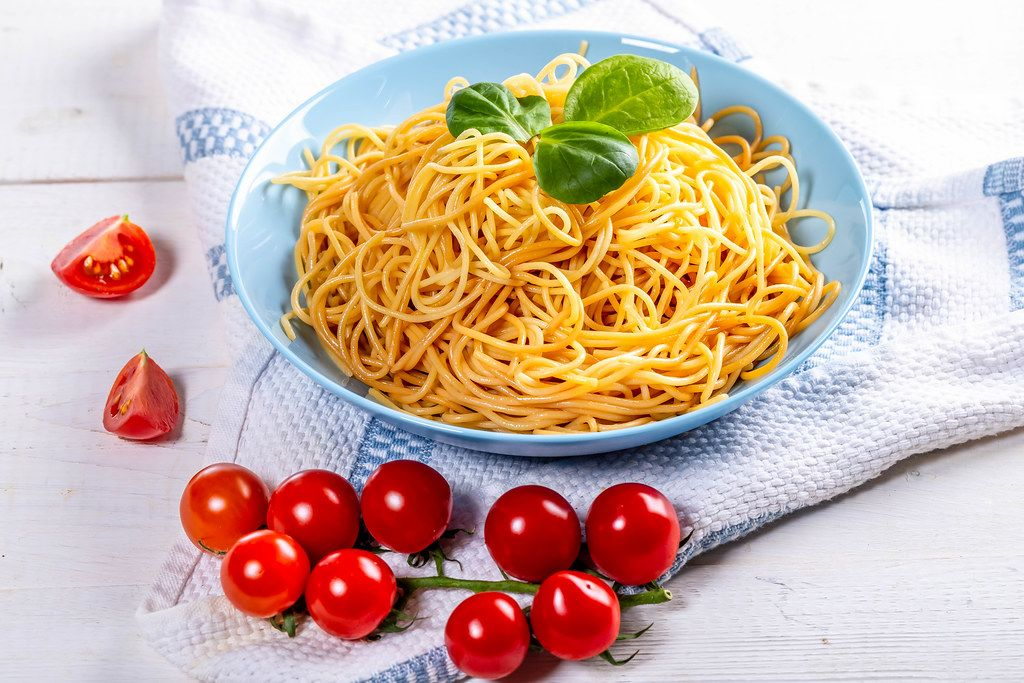 Full plate of delicious spaghetti with tomatoes (Flip 2019)