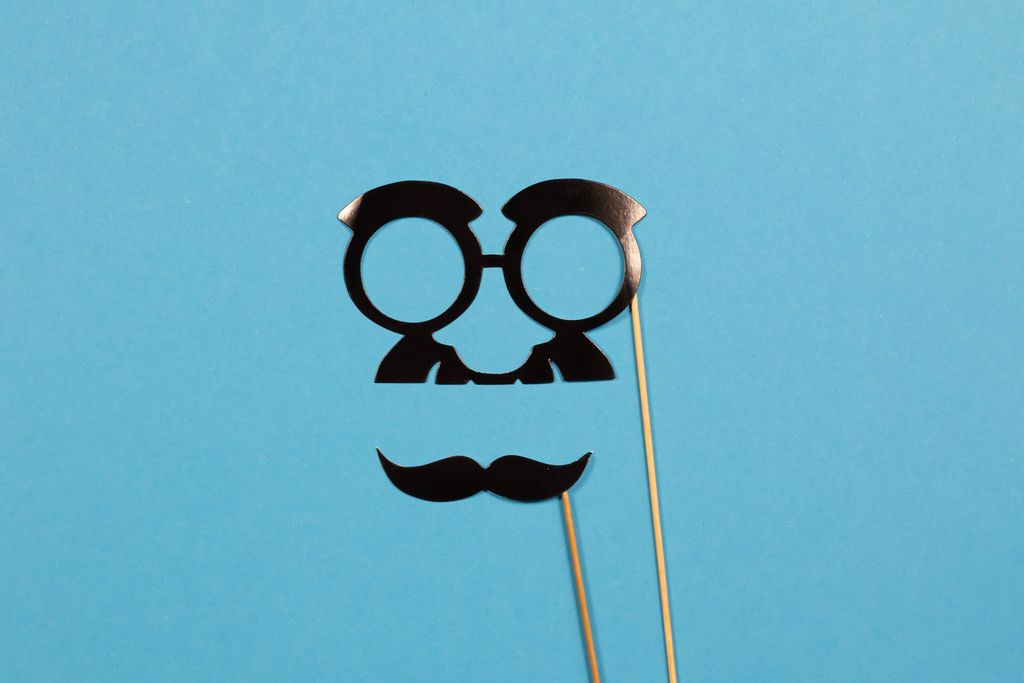 Funny mustache and glasses on sticks