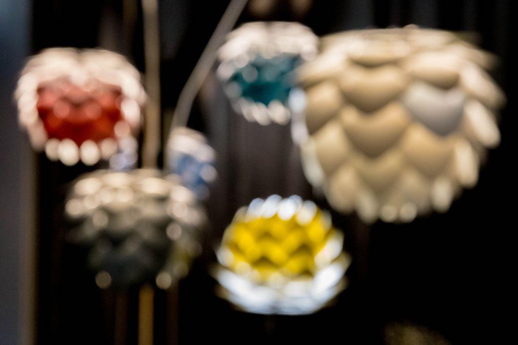 Futuristic aluminum lamps provide warm, insulated light - bokeh effect