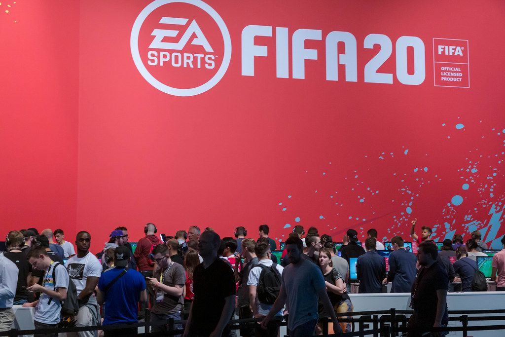 Gamescom visitors wait in line to play the soccer simulation game Fifa 20 by EA Sports